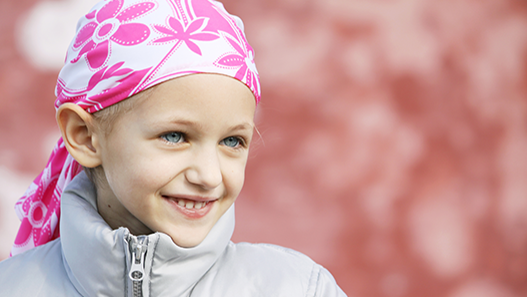 Young girl wearing white and pink head bandana