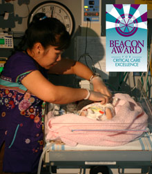 [PICU Nurse With Baby]