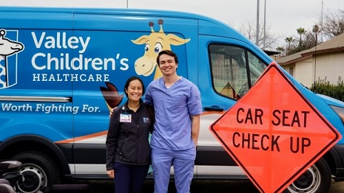 Photo of Valley Children's residents at community car seat check event