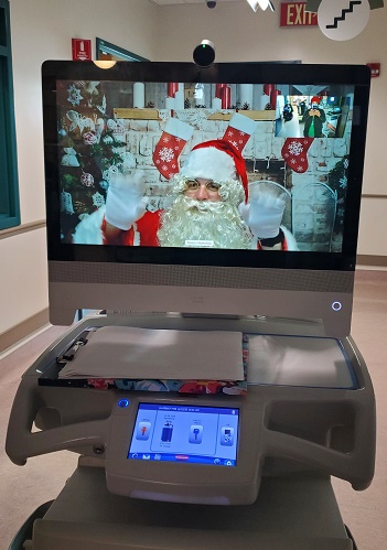 Virtual Santa on portable cart screen